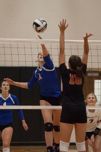 Jen Forbus - The Morning Journal<br> North Olmsted's Erica Merth leaps to try and block Bay's Lilah Cooper on Aug. 18.