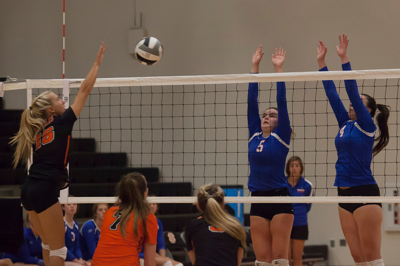 Jen Forbus - The Morning Journal<br> North Olmsted's Eve Kobak sends the ball over the net where Rockets Lauren McClure (left) and Maggie McAndrews are ready to block on Aug. 18.