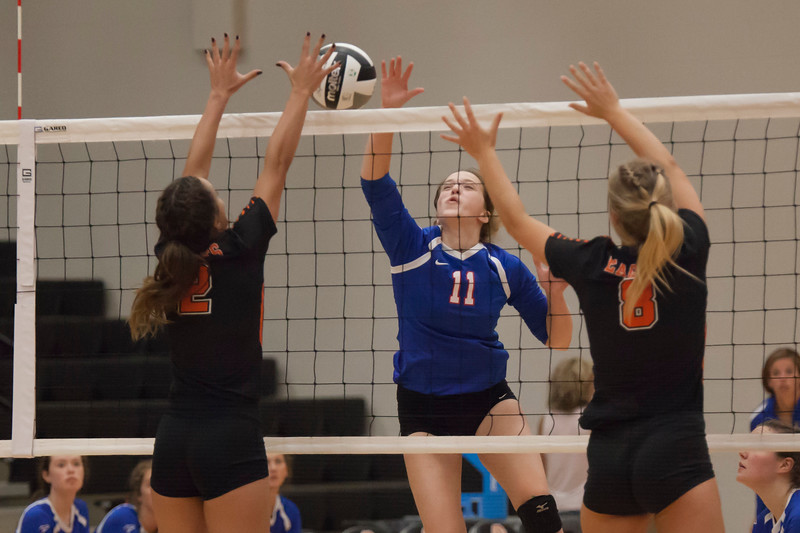Jen Forbus - The Morning Journal<br> Bay's Lilah Cooper goes for a spike as North Olmsted's Jordan Tessmer and Zinta Frigic try and block on Aug. 18.