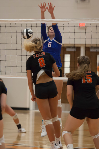Jen Forbus - The Morning Journal<br> Bay's Ella Boyer goes up to try to block a shot from North Olmsted's Zinta Frigic on Aug. 18.