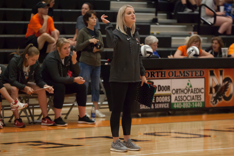 Jen Forbus - The Morning Journal<br> North Olmsted coach Mary Kate Evans gives her players direction from the sideline on Aug. 18.