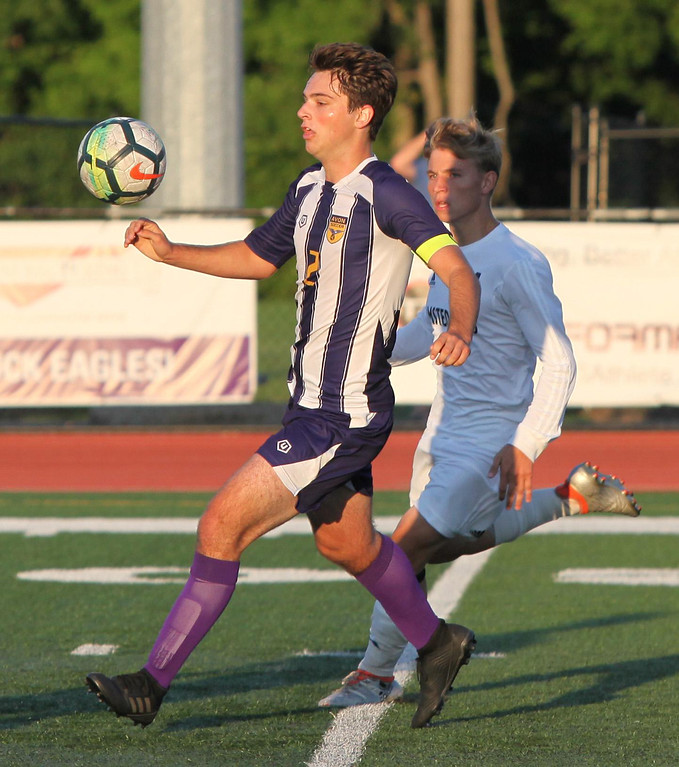. Randy Meyers - The Morning Journal Avon\'s Tyler Muir runs down a high  bounce in front of Jake Patay of Olmsted Falls during the first half on  Wednesday