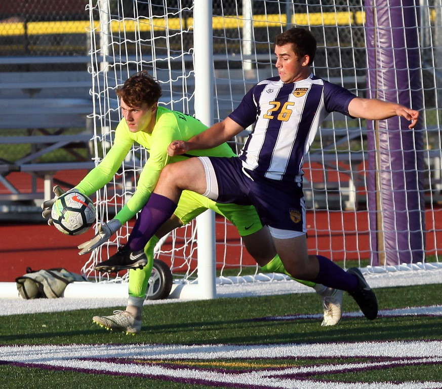. Randy Meyers - The Morning Journal Olmsted Falls goalkeeper Max  Kasputis makes a save at the goal in front of Avon\'s Nick Minotti during  the first half on Wednesday Aug 22