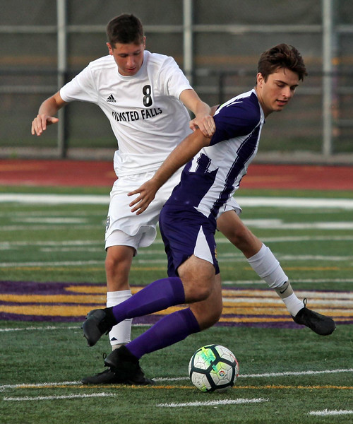 Randy Meyers - The Morning Journal<br /> Alex Gibson of Olmsted Falls pulls  Tyler Muir of Avon from behind during the first half on Wednesday
