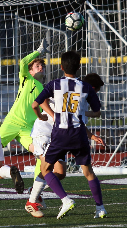 . Randy Meyers - The Morning Journal Olmsted Falls goalkeeper Max  Kasputis deflects a kick at the goal by Avon\'s Jin Nakano during the first  half on Wednesday
