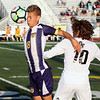 Randy Meyers - The Morning Journal<br /> Avon's Drew Whited heads the ball  in front of Jeremy Sgro of Olmsted Falls at the sideline during the first  half on Aug 22