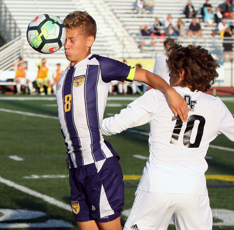 . Randy Meyers - The Morning Journal Avon\'s Drew Whited heads the ball  in front of Jeremy Sgro of Olmsted Falls at the sideline during the first  half on Aug 22