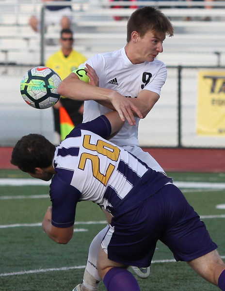 Randy Meyers - The Morning Journal<br /> Avon's Nick Minotti collides with  Alex Klek of Olmsted Falls at the ball during the first half on Wednesday  Aug 22