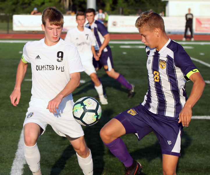 Randy Meyers - The Morning Journal<br /> Avon's Drew Whited controls the  ball at the sideline in front of Alex Klek of Olmsted Falls during the  first half on Wednesday