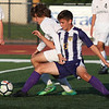 Randy Meyers - The Morning Journal<br /> Jeremy Sgro of Olmsted Falls and  Keegan Dawson of Avon battle for the ball near midfield during the first  half on Wednesday Aug 22