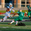 Anton Albert - The News-Herald<br /> Benedictine's Diego Bremer tries to eldue a Youngstown Ursuline defender on Aug. 25.