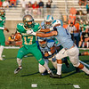 Anton Albert - The News-Herald<br /> Benedictine's Evan Tytko (4) and teammates make a tackle against Youngstown Ursuline on Aug. 25.