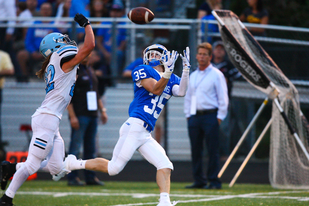 . 2018 - Football - Willoughby South at NDCL.  NDCL defeated Willoughby South 41 to 28.   NDCL wide receiver Alec Roberts (35) catches a pass and runs for a TD past South\'s Danny Gallagher (22).