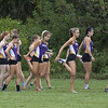 Jen Forbus - The Morning Journal<br />  The Avon girls cross country squad stretches before the start of the SWC Preview at Lorain County Community College.