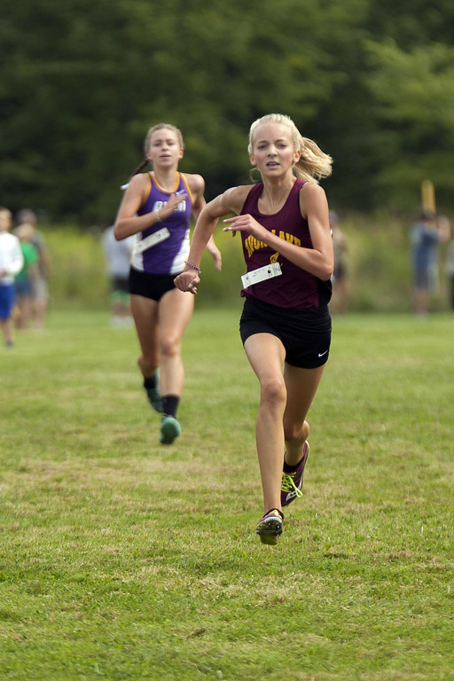 . Jen Forbus - The Morning Journal Sprinting for the finish line to finish third is Avon Lake sophomore Maggie Jantz who finished just ahead of Avon sophomore Meadow Smith.