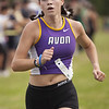 Jen Forbus - The Morning Journal<br /> Crossing the finish line second for the girls is Avon senior Jules Frombach.