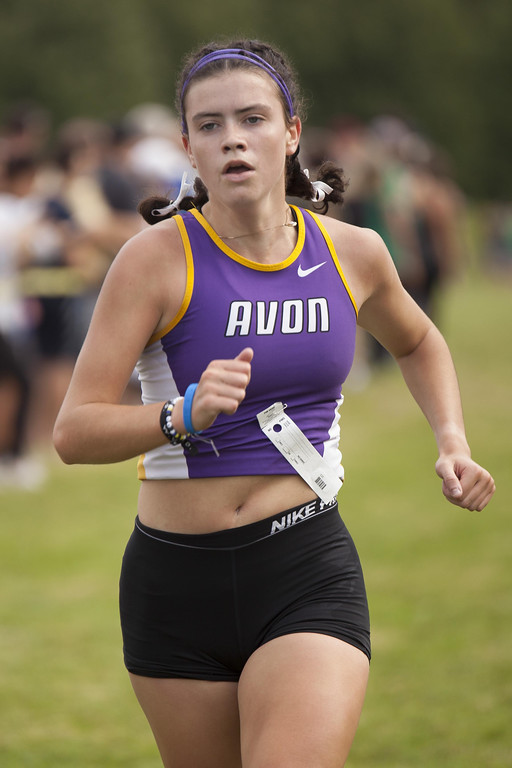 . Jen Forbus - The Morning Journal Crossing the finish line second for the girls is Avon senior Jules Frombach.