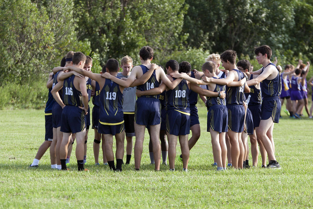 . Jen Forbus - The Morning Journal  The North Ridgeville boys cross country squad joins arms before the start of the race.
