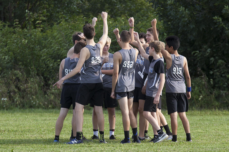 Jen Forbus - The Morning Journal<br /> The Midview boys cross country squad huddles up before the start of the race.