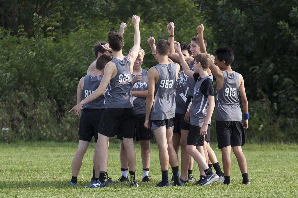 . Jen Forbus - The Morning Journal The Midview boys cross country squad huddles up before the start of the race.