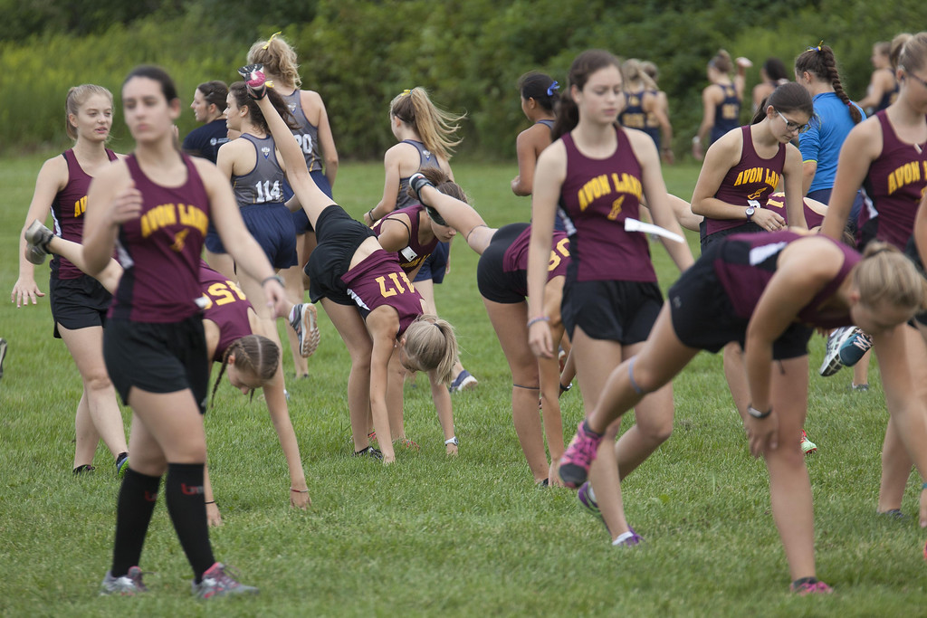 . Jen Forbus - The Morning Journal Avon Lake\'s girls cross country team warms up before the race.