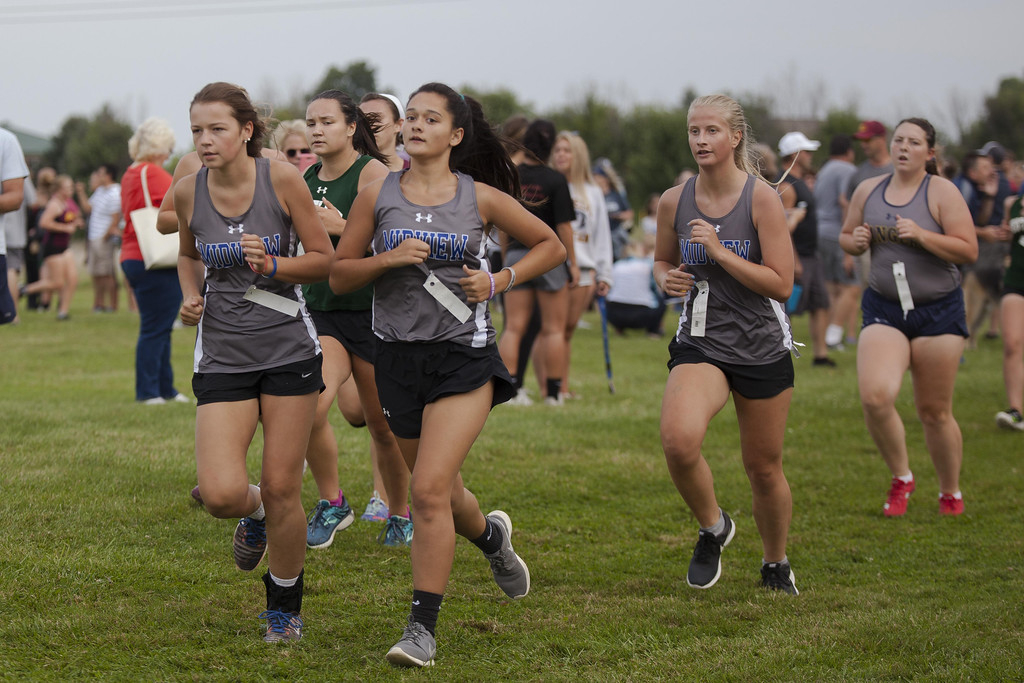 . Jen Forbus - The Morning Journal Members of the Midview cross country team help pace each other during the race.