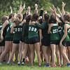 Jen Forbus - The Morning Journal<br /> The Westlake girls cross country squad huddles up before the start of the race.