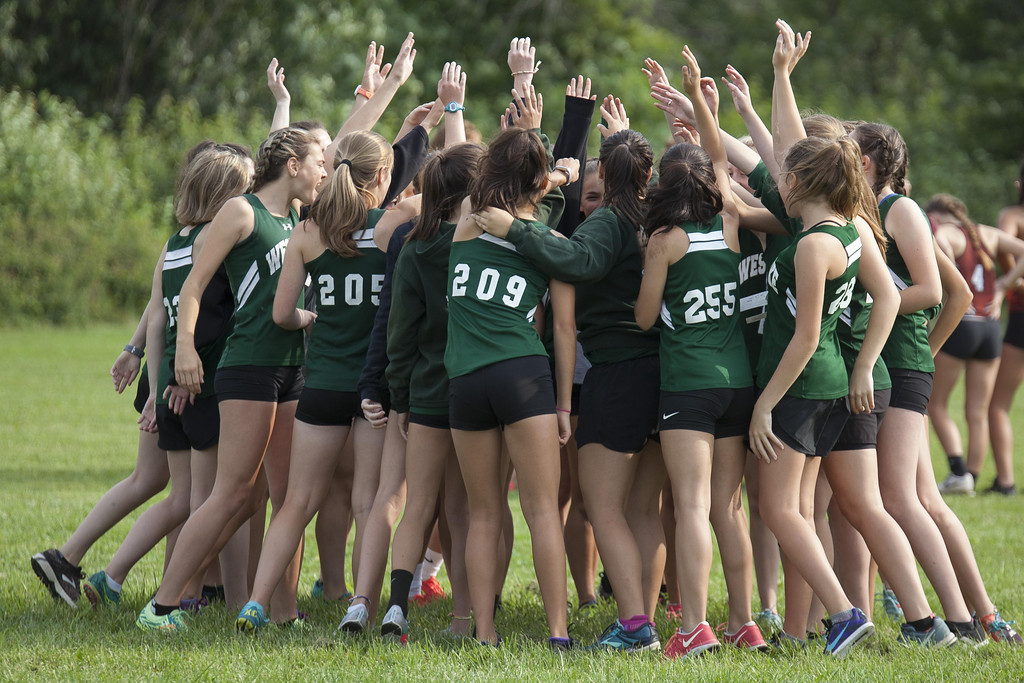 . Jen Forbus - The Morning Journal The Westlake girls cross country squad huddles up before the start of the race.