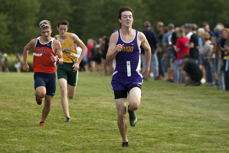 Jen Forbus - The Morning Journal<br /> Avon senior Luke Gardner gives one last push to finish fourth in front of Berea Midpark's Ethan Bradt and Amherst Steele's Matthew Kirsch.
