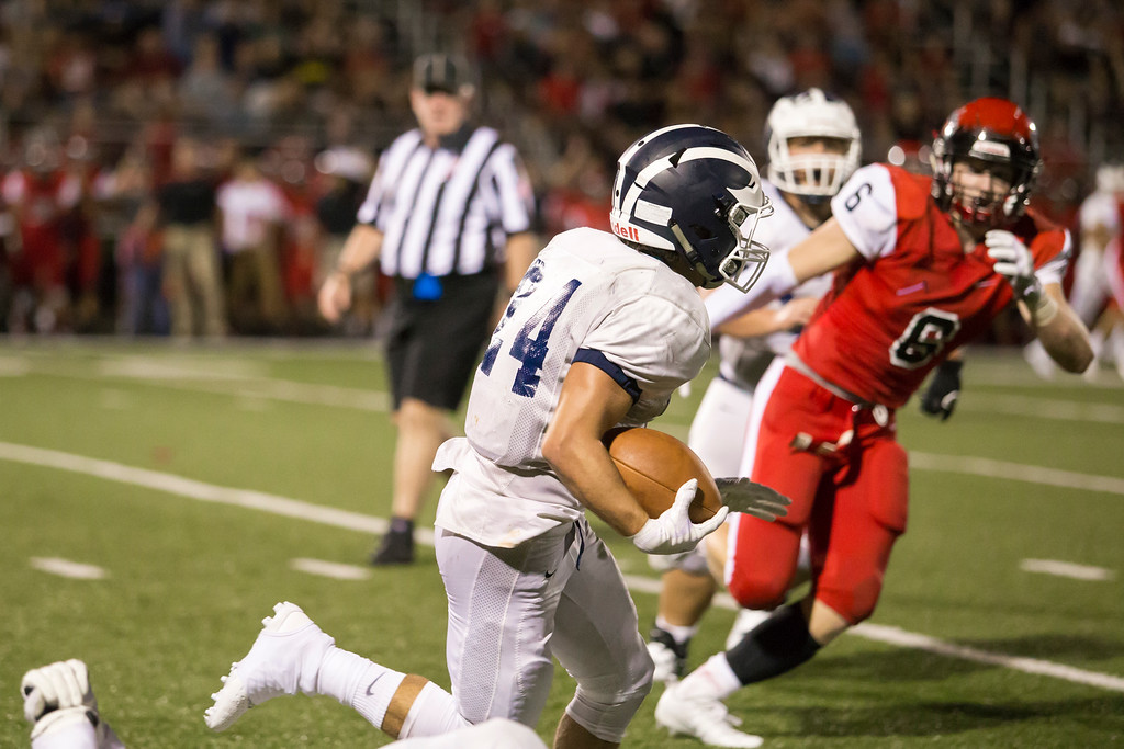 . Carrie Garland - The News-Herald Joe Daddario breaks a tackle on a West Geauga running play.