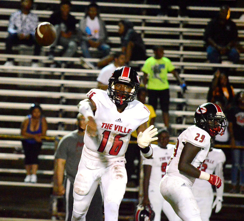 . Brittany Chay - The News-Herald Glenville\'s Jamel Hamm throws against Euclid on Aug. 25 at Euclid.