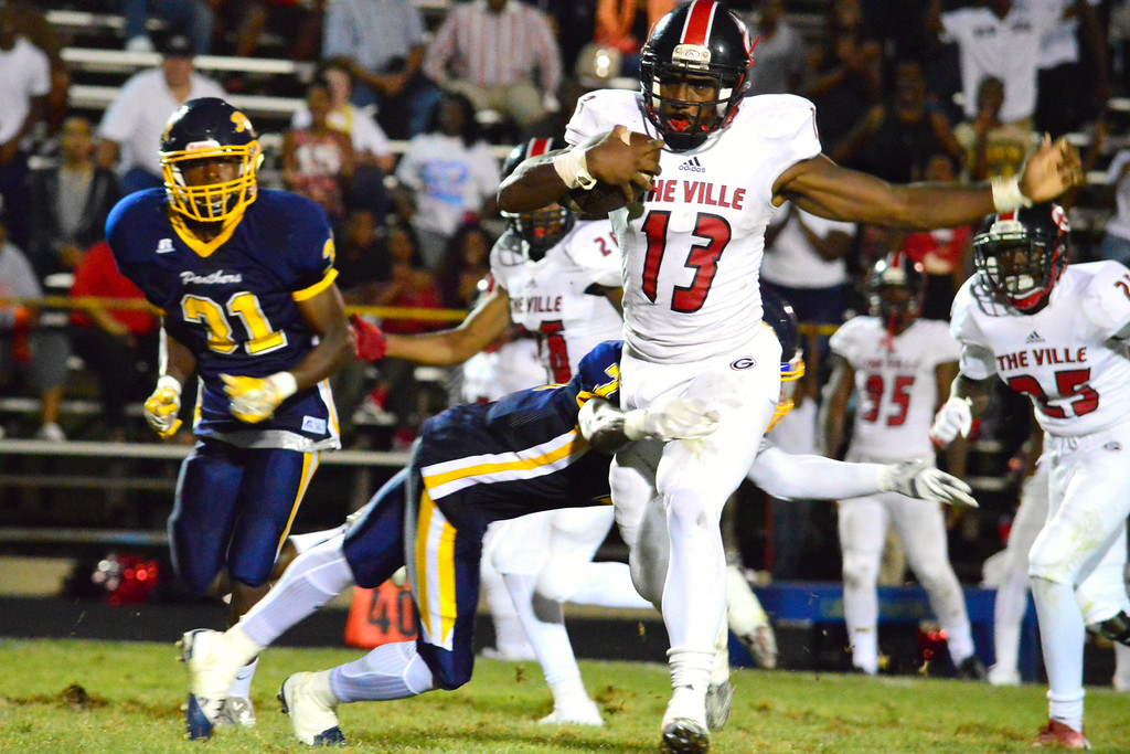 . Brittany Chay - The News-Herald Glenville\'s Jaylon Carver rushes against Euclid on Aug. 25 at Euclid.