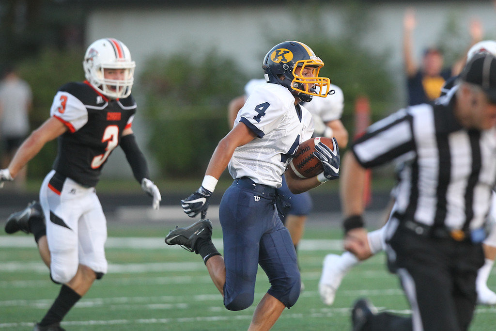 . David Turben - The News-Herald Kirtland running back Joey Torok (4) breaks a long touchdown in the second quarter to put Kirtland into the lead pursued by Chagrin Falls cornerback Will Bargar.
