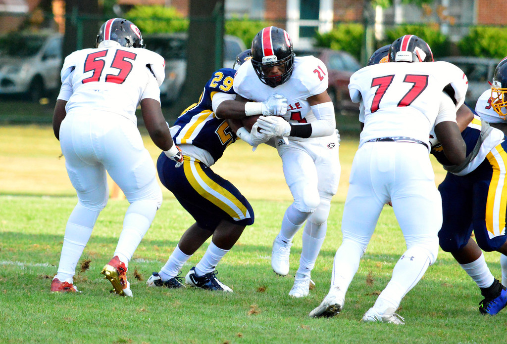 . Brittany Chay - The News-Herald Glenville\'s Sylvester Harris rushes against Euclid on Aug. 25 at Euclid.