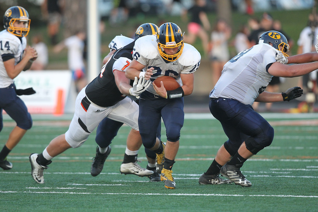 . David Turben  - The News-Herald  Kirtland running back Gaige Ward (26) rushes up the middle.