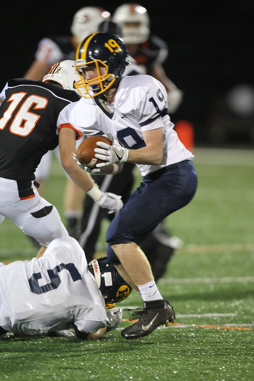 . David Turben - The News-Herald Kirtland defensive back Palmer Capretta (19) intercepts the ball on a deflection of a pass intended for Chagrin Falls receiver Andrew Kwasny (16) and defended by Kirtland defensive back Mike Zeuli (5).