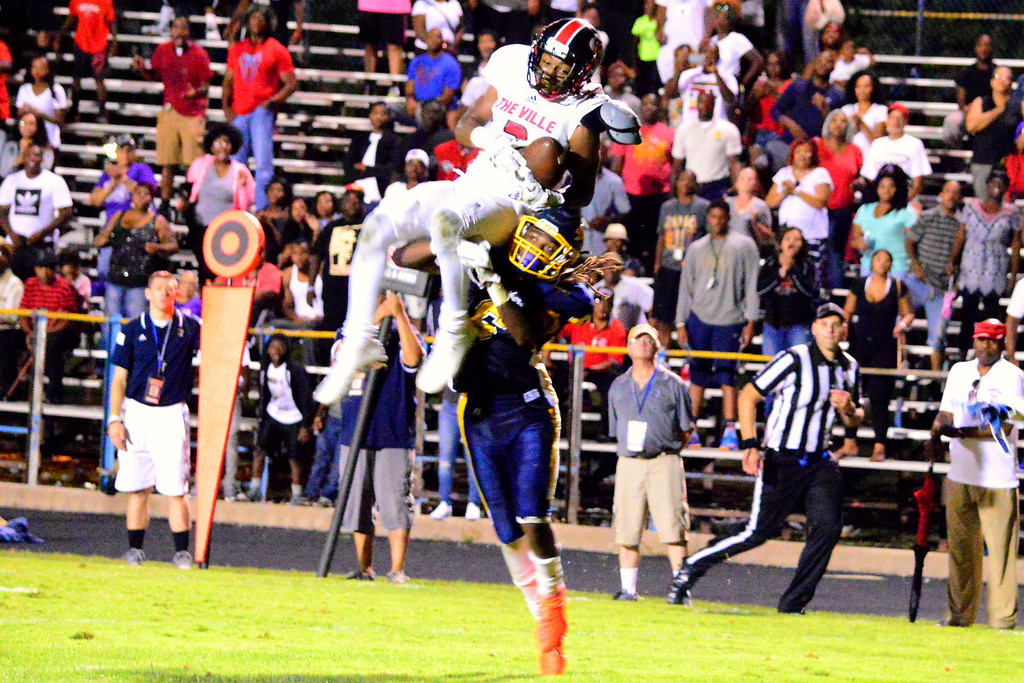 . Brittany Chay - The News-Herald Glenville\'s Coby Bryant tries to make a catch against Euclid on Aug. 25 at Euclid.