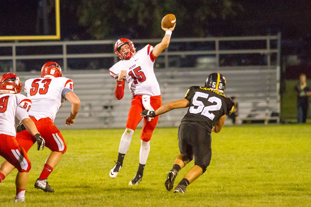 . Barry Booher - The News-Herald Perry�s Kolston Brewster fires a touchdown pass over Riverside�s Cj Cantrell.