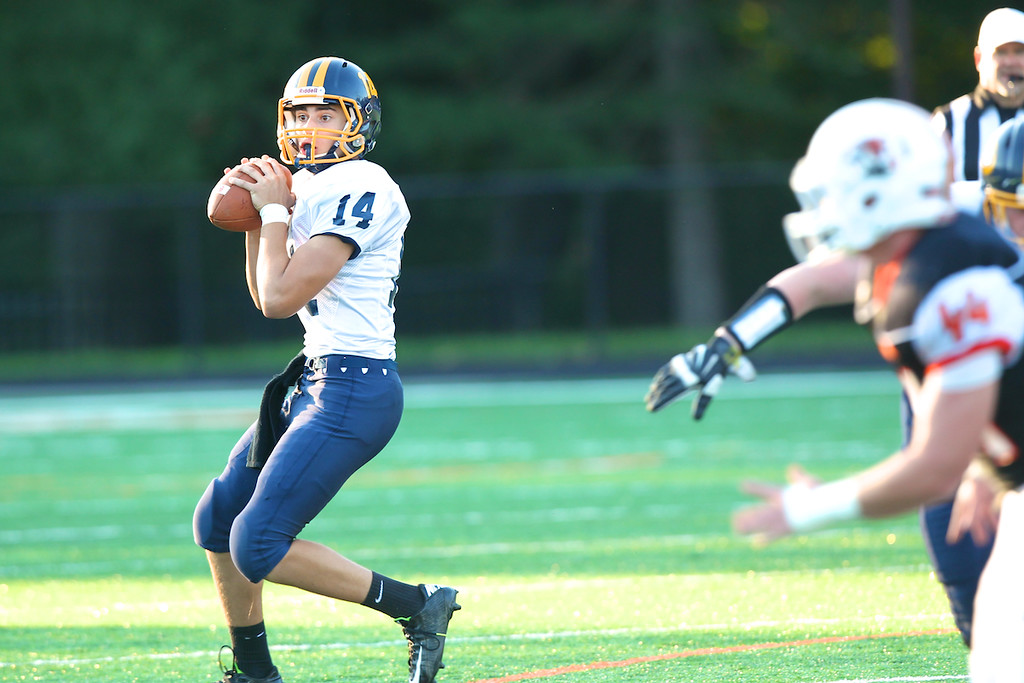 . David Turben - The News-Herald Kirtland QB Dylan Fulco looks for his receiver downfield.