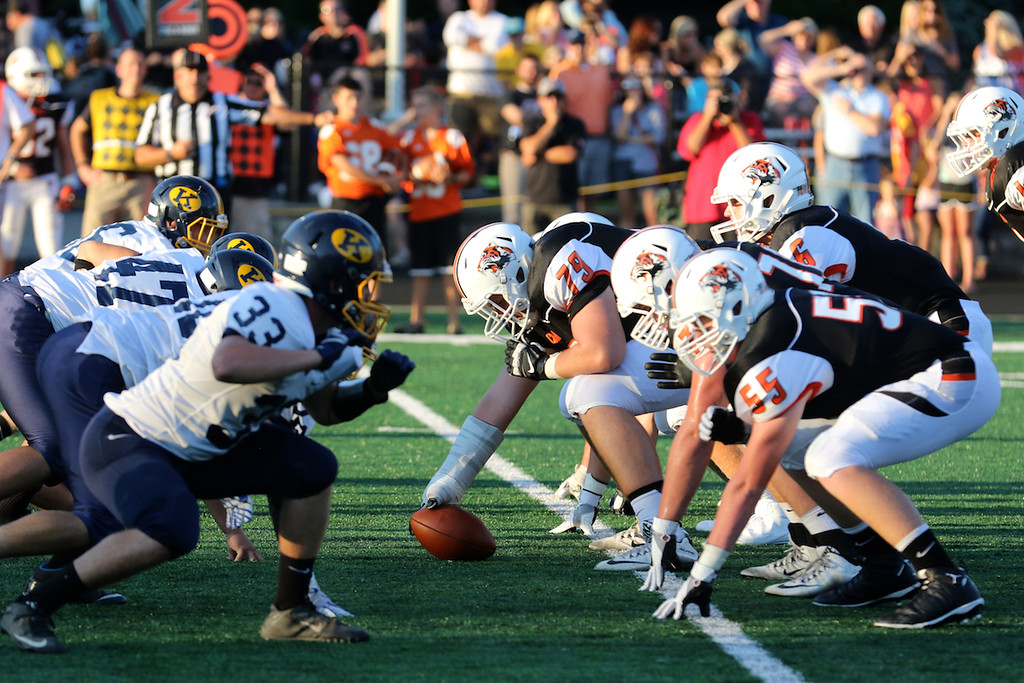 . David Turben - The News-Herald  Chagrin Falls offense prepares to hike the ball against Kirtland.