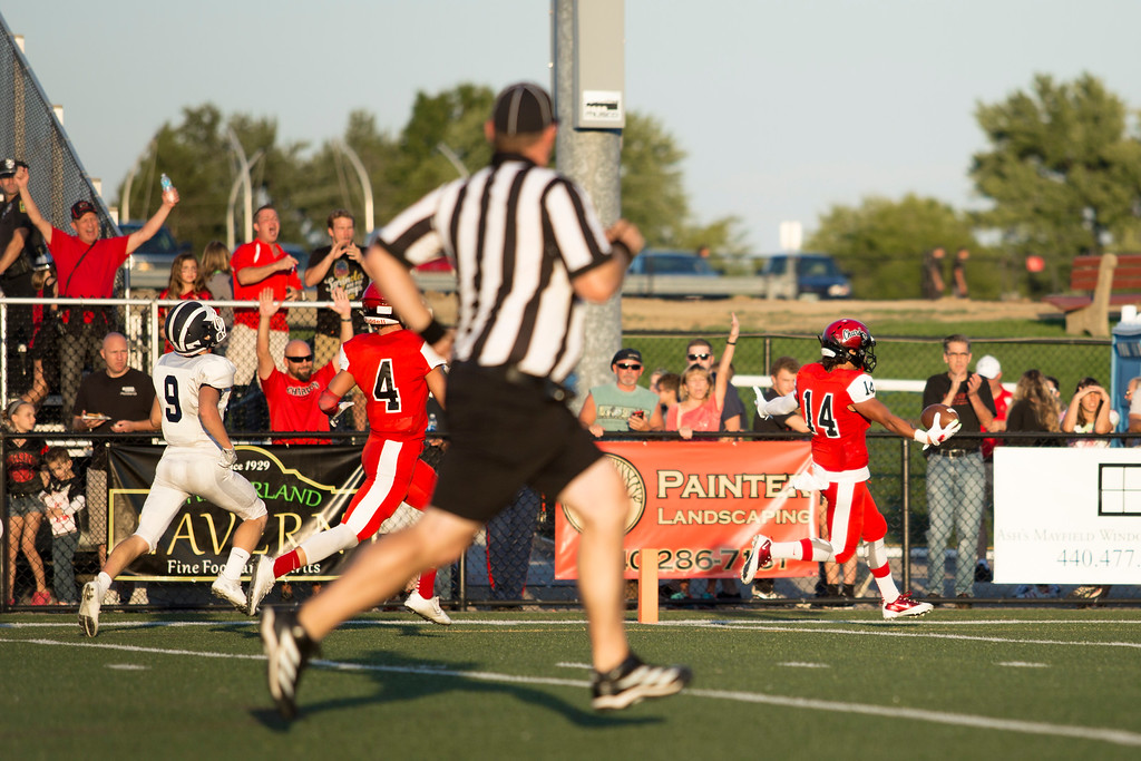 . Carrie Garland - The News-Herald  Beck Thompson runs in for a Chardon touchdown.