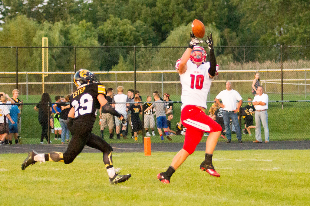 . Barry Booher - The News-Herald Perry�s Andrew Foley gets behind Riverside�s Dylan Estep for a 43 yard TD reception.