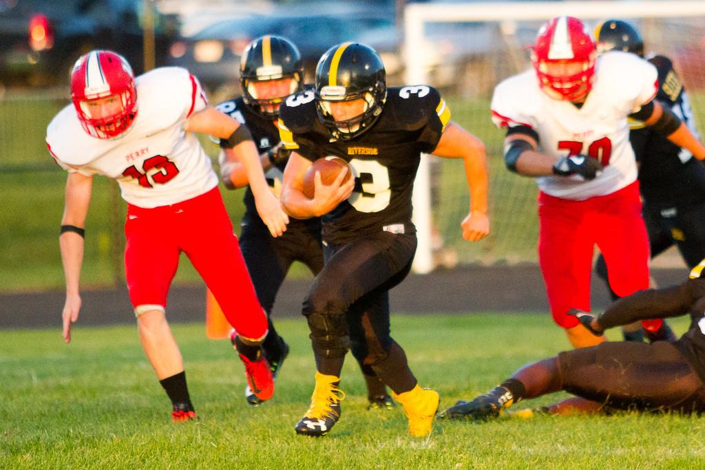 . Barry Booher - The News-Herald Riverside�s Austin Van Pelt, runs through the hole for an 80 yard touchdown.