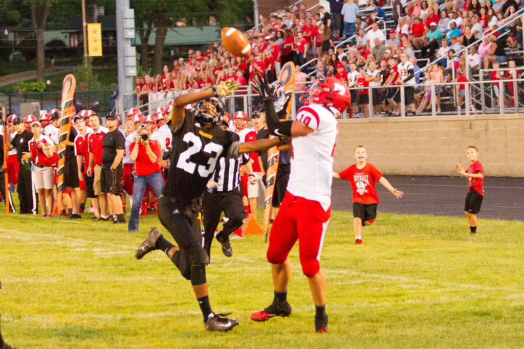 . Barry Booher - The News-Herald Perry�s Andrew Foley beats Riverside�s Rogelio Claudio on a 30 yard TD pass.