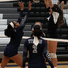 Randy Meyers - The Morning Journal<br /> Columbia's Amelia Hritz blocks the  tap back at the net by Aliyah Thomas of Lorain on Saturday