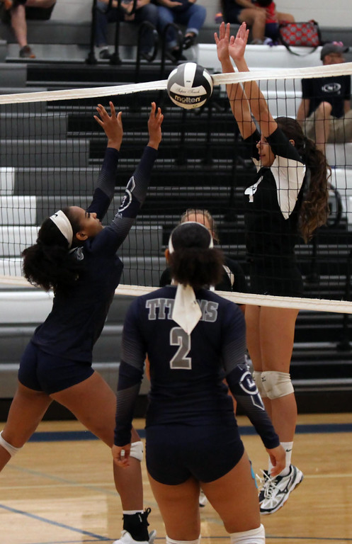 . Randy Meyers - The Morning Journal Columbia\'s Amelia Hritz blocks the  tap back at the net by Aliyah Thomas of Lorain on Saturday