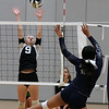 Randy Meyers - The Morning Journal<br /> Lorain's Jerzy Fiske taps the ball  over Columbia's Morgan Davis during the second set on Saturday.