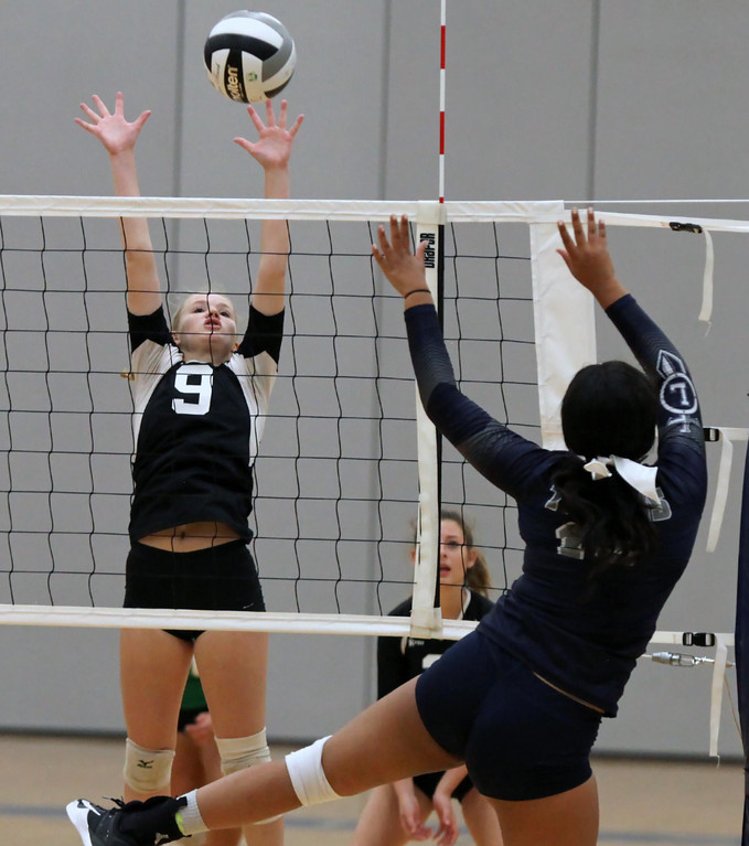 . Randy Meyers - The Morning Journal Lorain\'s Jerzy Fiske taps the ball  over Columbia\'s Morgan Davis during the second set on Saturday.