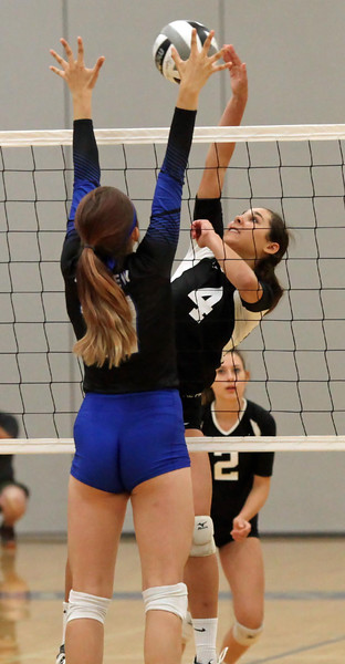 Randy Meyers - The Morning Journal<br /> Midview's Rachael Spayd partially  blocks the spike attempt by Columbia's Amelia Hritz during the first set on  Saturday