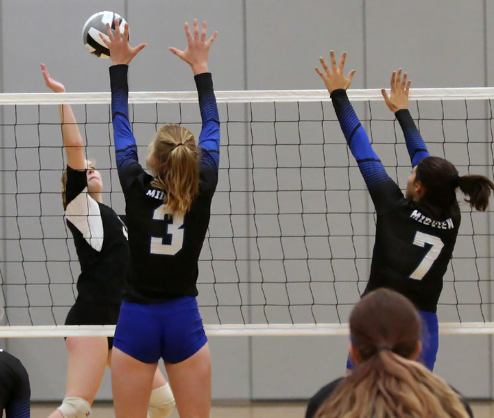 Randy Meyers - The Morning Journal<br /> Columbia's Laci Riley returns a  shot at the net against Lindsey Frambach (left) and Alyssa Awad of Midview  on Saturday